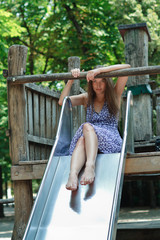 woman on a child slide