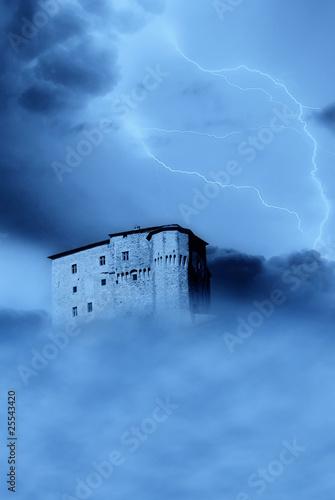 isolated castle shrouded by the fog