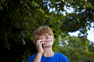 young boy talking on a cell phone.