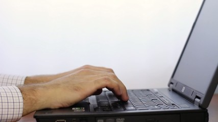 Man open and Typing on Laptop