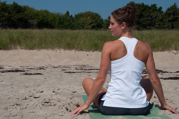 Woman in Profile on Yoga Mat on Beach