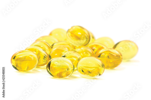 Yellow Vitamin Oil Capsules Macro Closeup Isolated