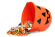 child halloween pumpkin bucket spilling candy - 25553896