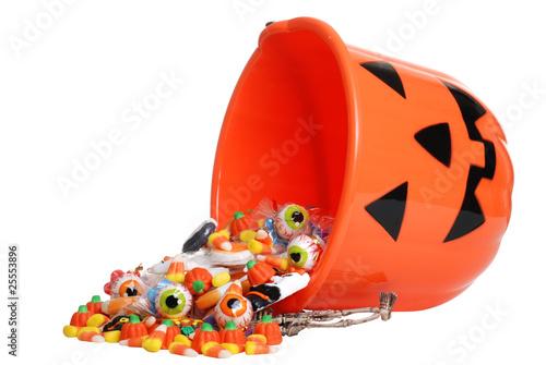 Fotobehang Snoepjes child halloween pumpkin bucket spilling candy