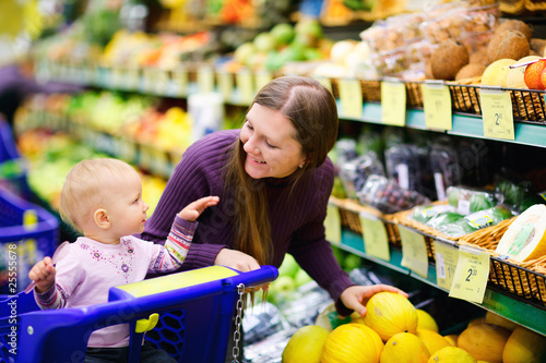 Family buying fruits in supermarket