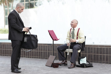 Businessman tipping the musician
