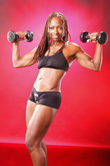 Toned african american and her dumbbell routine