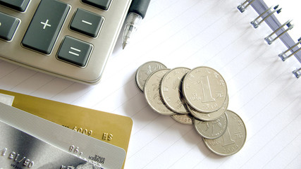 Coins and calculator and credit cards