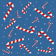 Candy cane background with snow flakes over blue