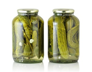 Glass jars with pickled cucumbers