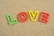 love written on sea sand