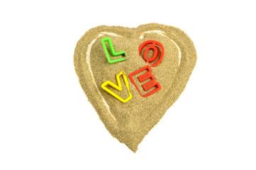 sand heart with love written