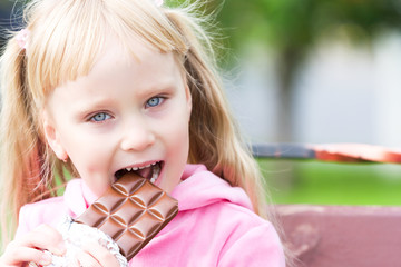 Happy little girl with a chocolates