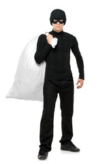 Full length portrait of a Thief holding a bag isolated against w