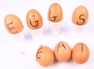 Eggs with an inscription EAT EGGS in egg holders