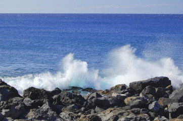 Breaking surf  on the coast of the Big Island Hawaii