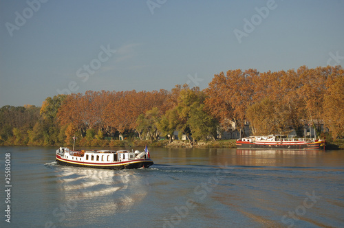 Colorful barges on the Rhone river at Avignon in France