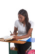 College student African American woman by desk