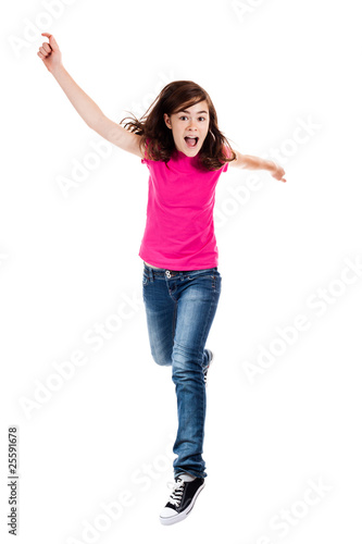Girl jumping, running isolated on white background