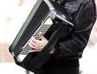 Street musician, accordion playing