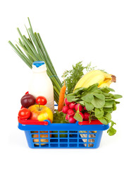 filled shopping basket over white background