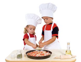 Kids preparing a pizza