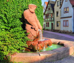Alleyway with fontain and statue in Lohr am Main, Germany