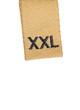 Macro of XXL size clothing label tag, isolated on white