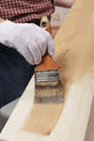 Varnishing a plank poster