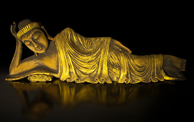 Teak wood lying buddha on black