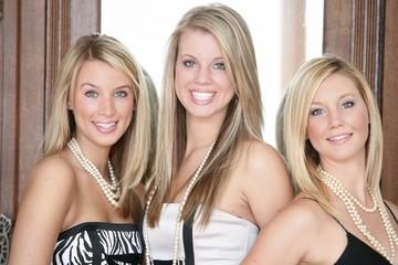Three Teenage Girls In Formal Wear