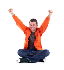 victory - young man sitting with raised arms