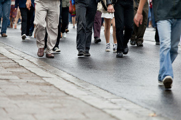 Crowd walking - group of people walking together (motion blur)