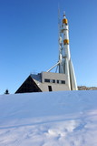 Three-stage space rocket against a blue sky in the winter