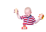 baby boy is playing with his wooden toy train isolated over whit
