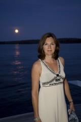 Woman On Dock At Night, Lake Of The Woods, Ontario, Canada