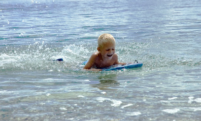 surfing boy - young boy learning to surf
