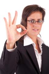 Business woman signaling ok