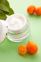 Face cream and fresh cumquats
