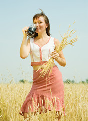 Girl  with quass and wheat ears