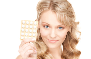 young woman with pills