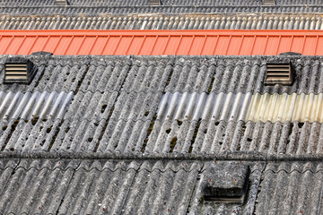 Row of roofs made of asbestos cement sheeting