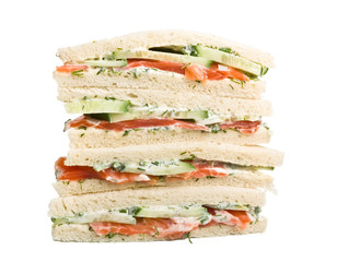 club tea sandwich with salmon and cucumbers on white bread