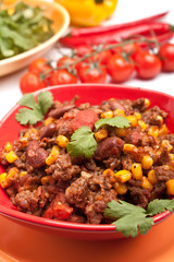 beef chili with beans,corns and cilantro