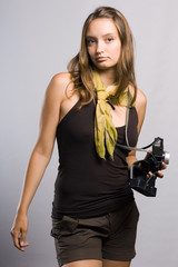 beautiful girl holding a photo camera.