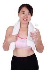 An Asian woman in fitness attire holding a bottle of water