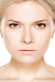 Cosmetology & cosmetic. BEAUTIFUL WOMAN APPLYING CREAM NEAR EYES poster