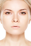 Cosmetology & cosmetic. Woman model with daily cream near eyes poster