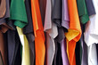 Row of colorful cotton t-shirts. Clothes background.