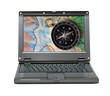 small laptop with compass and map